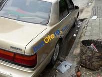 Bán Mazda 929 đời 1990, màu vàng số tự động, giá 95tr