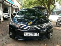 Bán ô tô Toyota Corolla altis 1.8G đời 2015, màu đen số tự động