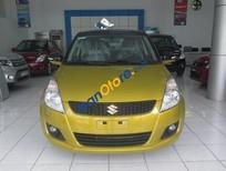 Cần bán xe Suzuki Swift AT đời 2016, màu vàng