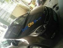 Bán Kia Rio 1.4AT sản xuất 2014, màu nâu