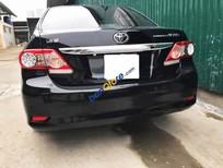 Cần bán gấp Toyota Corolla Altis 1.8AT đời 2013, màu đen, giá 715tr