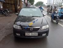 Cần bán xe Mazda 323 sản xuất 2003, màu đen số sàn