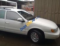 Cần bán Ford Taurus đời 1995, màu trắng, nhập khẩu nguyên chiếc xe gia đình