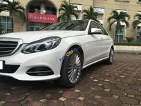 Cần bán Mercedes Benz E400 mầu trắng, chính chủ gia đình sử dụng, xe còn mới SX 2014