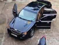 Cần bán lại xe Daewoo Magnus AT đời 2004, màu đen số tự động, giá tốt