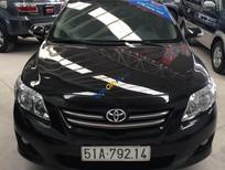 Bán Toyota Corolla altis 1.8MT số sàn đời 2009, màu đen, giá 560 triệu