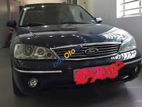 Cần bán xe cũ Ford Laser 1.6MT đời 2004, màu xanh lam giá cạnh tranh