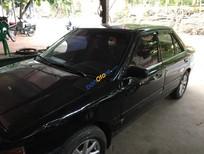 Cần bán xe Mazda 323 đời 1995, màu đen, nhập khẩu chính hãng, giá chỉ 75 triệu