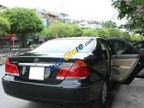 Bán xe chính chủ Toyota Camry 3.0 V6 đời 2004, màu đen, giá tốt