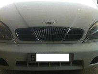 Cần bán Daewoo Lanos đời 2005, màu trắng, đồng sơn xe còn zin nguyên