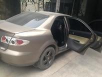 Cần bán xe Mazda 6 2004, màu vàng, 299 triệu