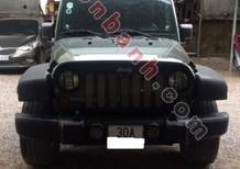 Cần bán gấp Jeep Wrangler Unlimited Sport 2010, màu đen, xe nhập chính chủ