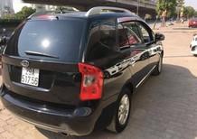 Xe Kia Carens đời 2010, màu đen số tự động