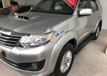 Cần bán Toyota Fortuner G 4x2AT đời 2013, màu bạc số sàn