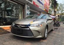 Bán xe Toyota Camry LE đời 2016, màu vàng, nhập khẩu nguyên chiếc, mới 100%