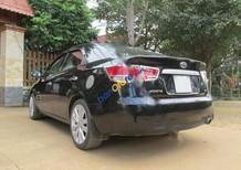 Cần bán gấp Kia Forte EX đời 2011, màu đen xe gia đình, 385 triệu