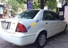 Gia đình cần bán Ford Laser MT sản xuất 2002, màu trắng, 210 triệu