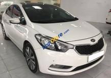 Cần bán xe cũ Kia K3 1.6AT đời 2014, màu trắng