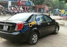 Bán xe cũ Daewoo Lacetti MT đời 2011, màu đen, giá chỉ 318 triệu