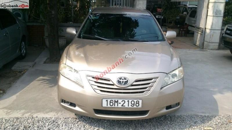 Xe Toyota Camry LE đời 2007, màu vàng, nhập khẩu, số tự động