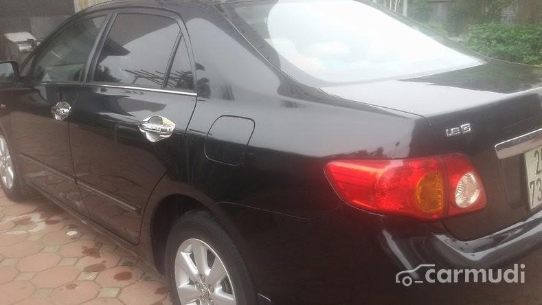 Cần bán Toyota Corolla Altis 1.8 MT đời 2010, màu đen chính chủ, giá chỉ 620 triệu