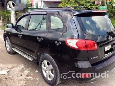 Cần bán lại xe Hyundai Santa Fe AT đời 2007, màu đen đã đi 92000 km