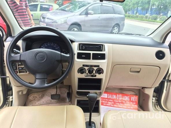 Bán ô tô Daihatsu Charade AT đời 2006, màu vàng đã đi 40000 km, giá 250tr