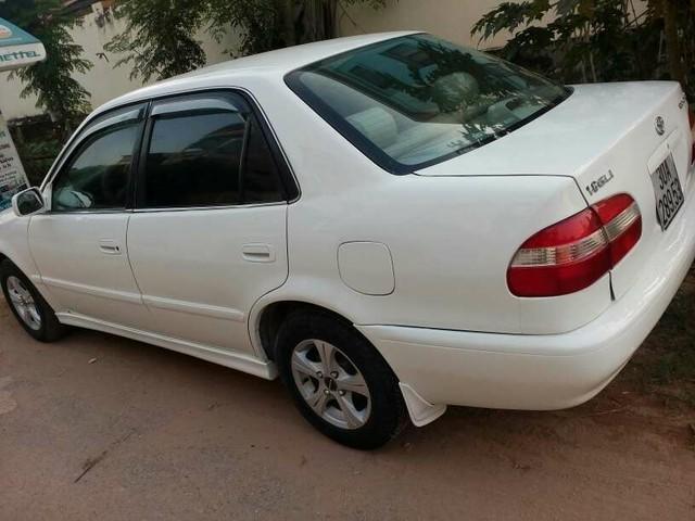 Cần bán lại xe Toyota Corolla XLI 1.6 Tubo đời 2013, màu trắng, nhập khẩu nguyên chiếc, như mới