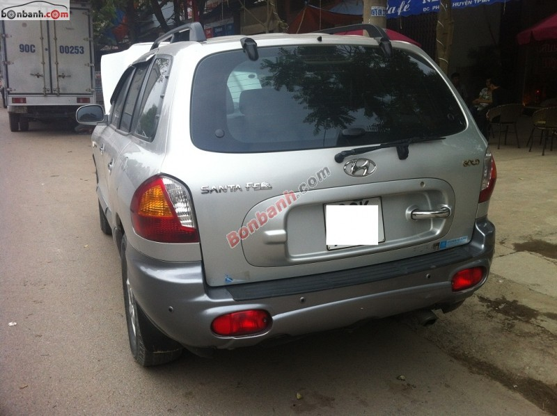Gia đình bán ô tô Hyundai Santa Fe đời 2004, màu bạc, xe nhập