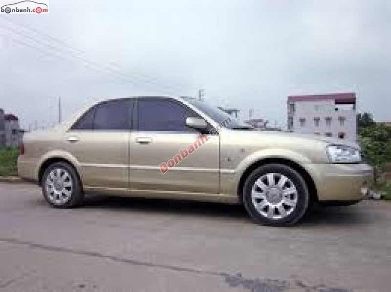 Bán ô tô Ford Laser 1.8AT đời 2003, màu vàng cát, giá 305Tr