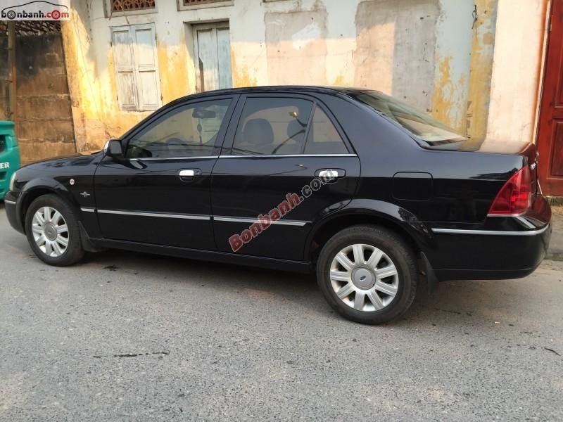 Ford Laser 1.8AT đời 2004, màu đen số tự động