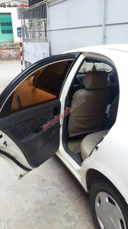 Do có nhu cầu đổi xe khác nên gia đình tôi cần bán Daewoo Lanos SX đời 2003, màu trắng, nhập khẩu nguyên chiếc