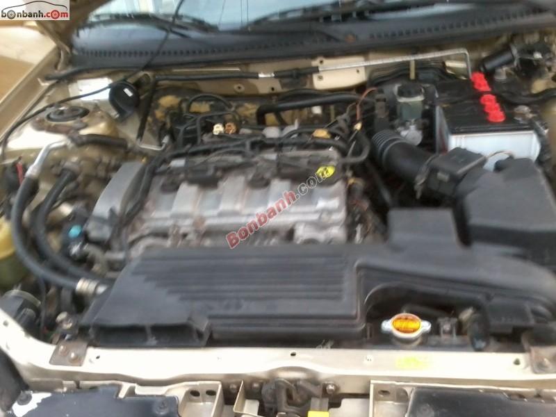 Cần bán Ford Laser Ghia 1.8 đời 2003, màu nâu, còn mới