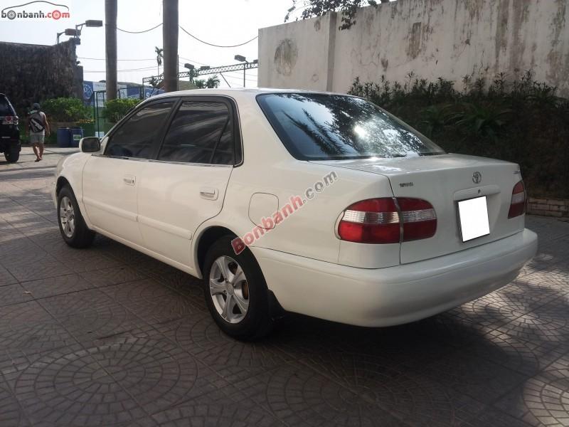 Mình cần bán Toyota Corolla đời 2000, màu trắng, nhập khẩu nguyên chiếc