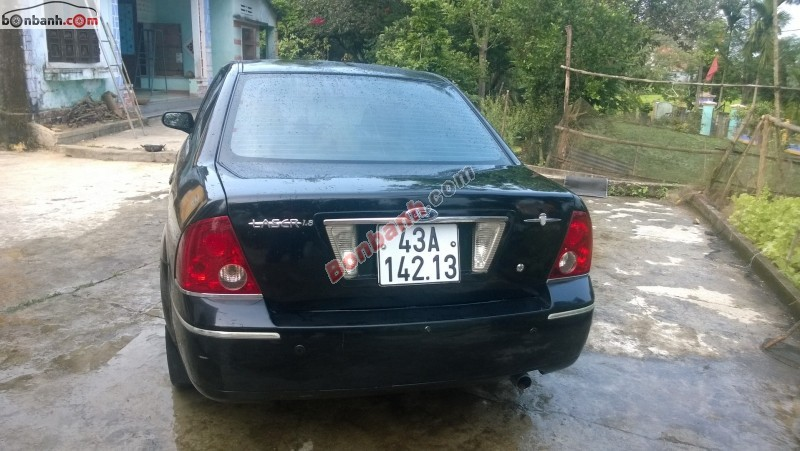 Xe Ford Laser 1.8AT sản xuất 2005, màu đen số tự động cần bán