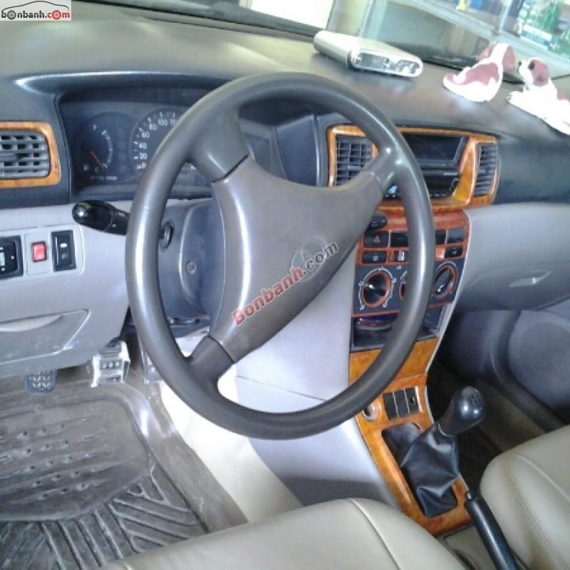Toyota Corolla đời 2003, màu đen chính chủ, 300 triệu