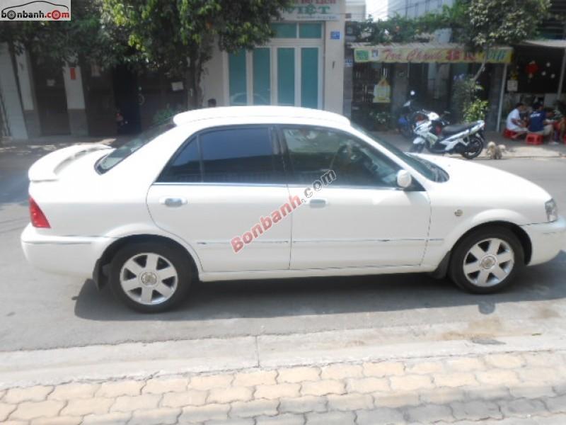 Xe Ford Laser GHIA đời 2003, màu trắng số sàn cần bán