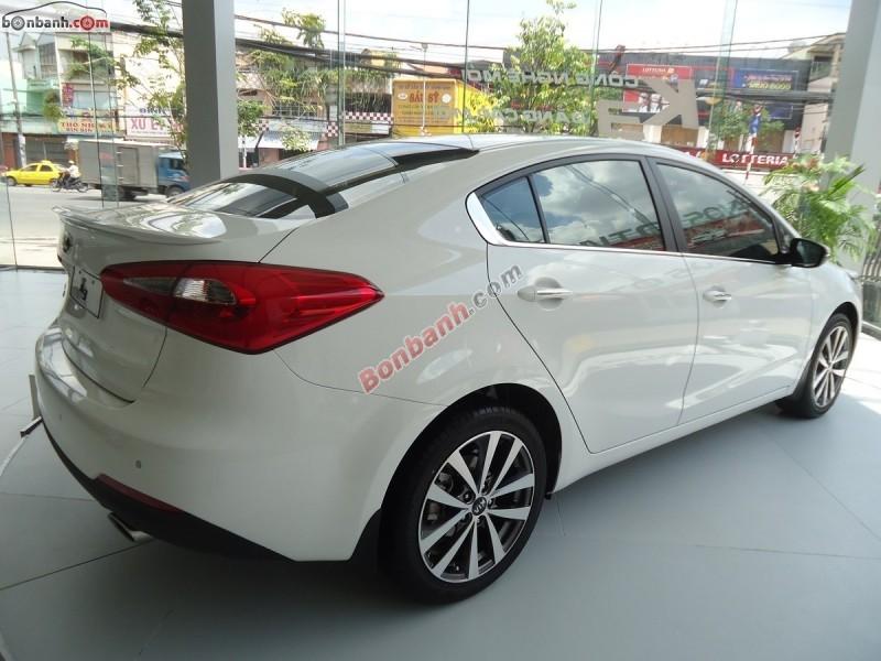 Cần bán xe Kia K3 1.6AT đời 2015, màu trắng, bản full options