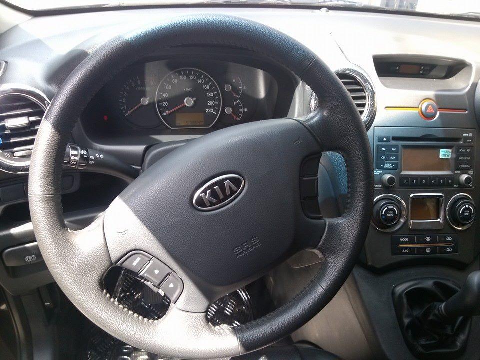 Cần bán xe Kia Carens đời 2010, màu đen, xe gia đình ít sài,