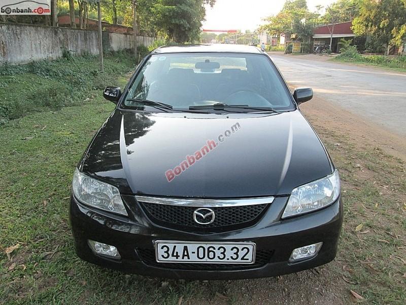 Xe Mazda 323  2004