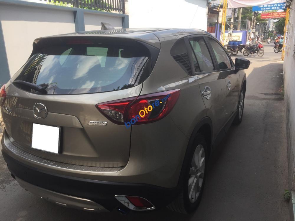 Xe Mazda CX 5 sản xuất năm 2015, màu vàng số tự động, 780tr