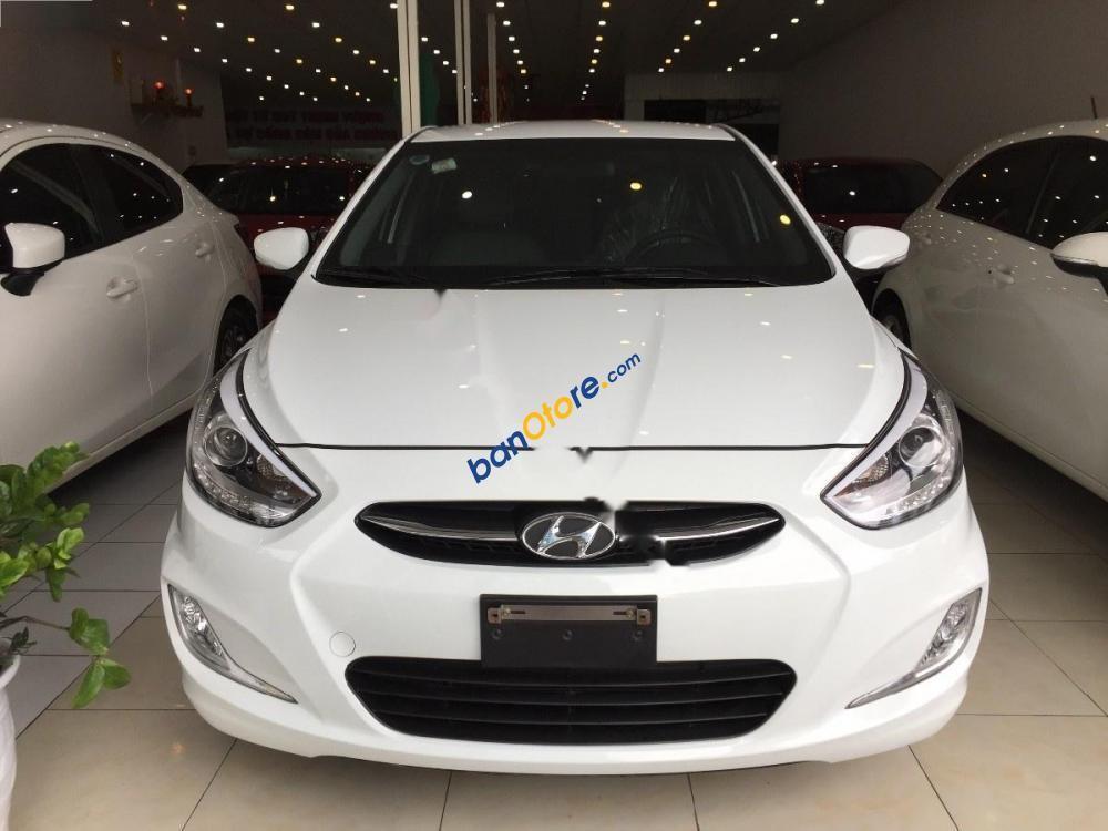 Cần bán lại xe Hyundai Accent 1.4MT sản xuất 2015, màu trắng, giá tốt