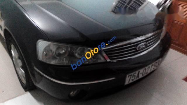 Bán xe cũ Ford Laser đời 2004, màu đen, nội thất ngoại thất đẹp