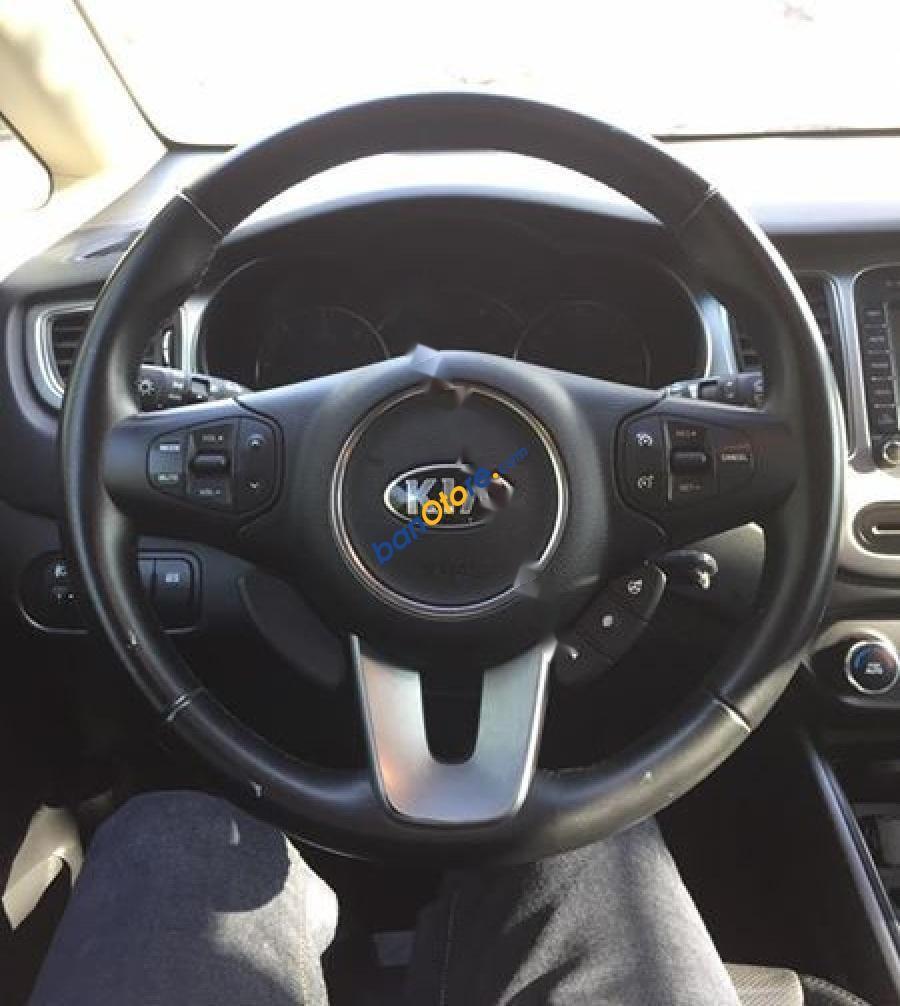 Bán xe Kia Rondo 1.7AT CRDi đời 2014, màu bạc như mới