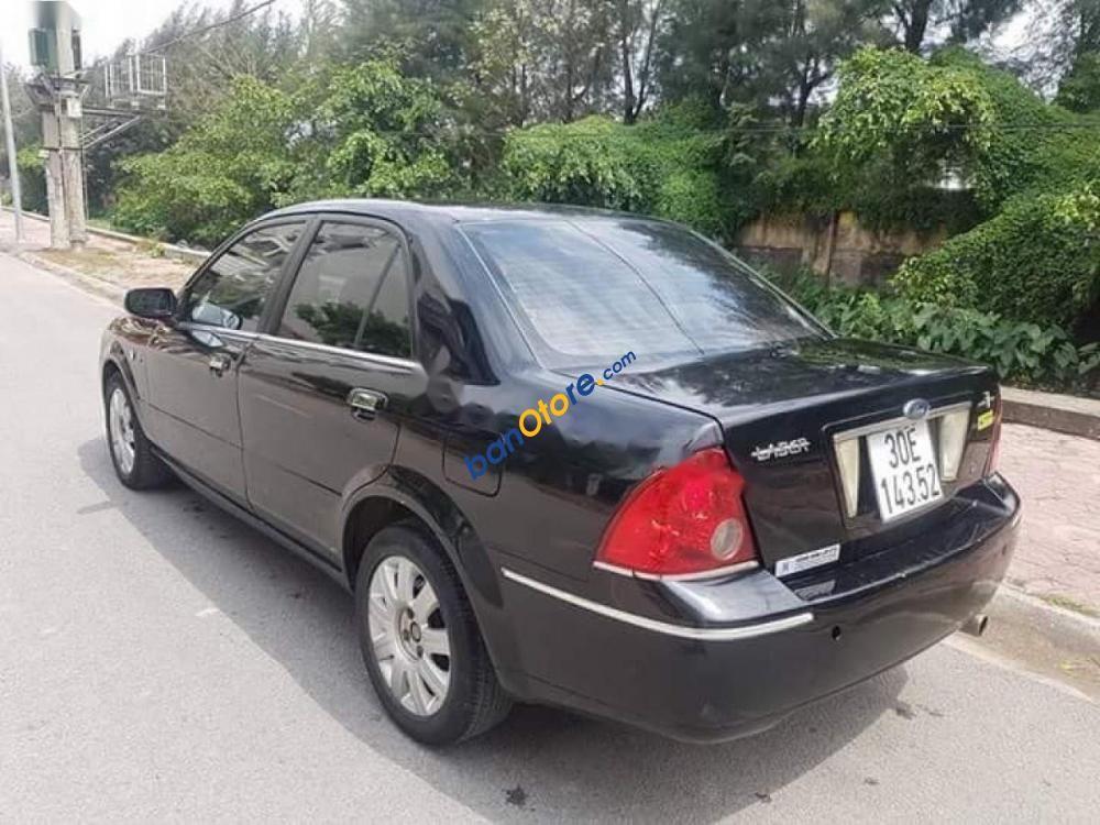 Bán Ford Laser sản xuất 2004, màu đen, phom mới