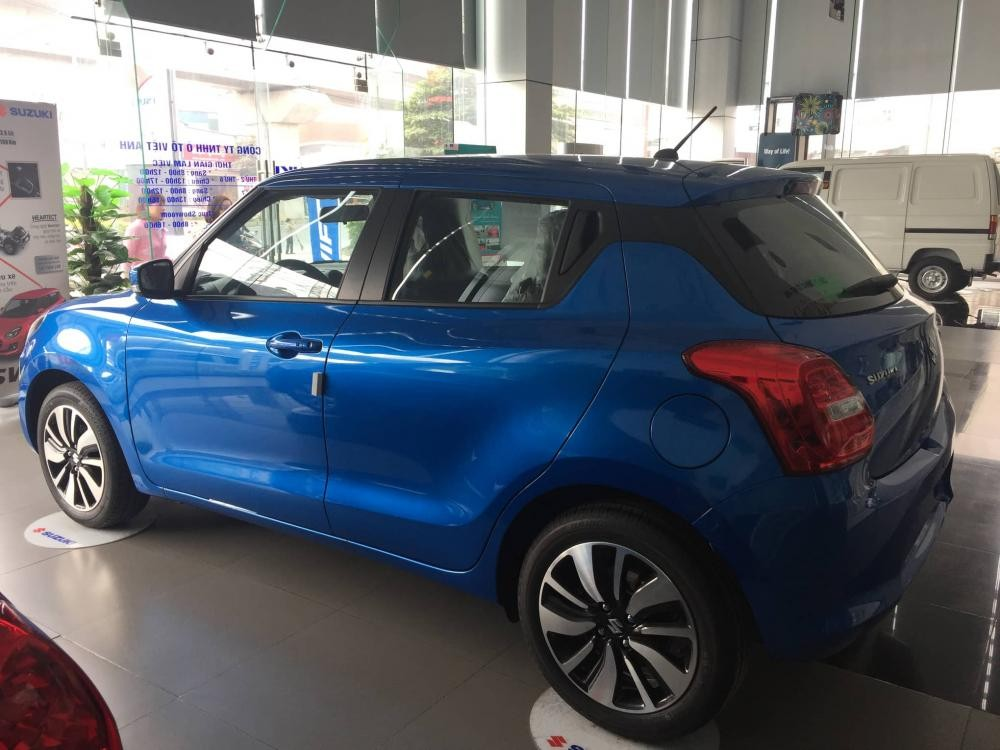 Cần bán xe Suzuki Swift GL sản xuất 2018, màu trắng