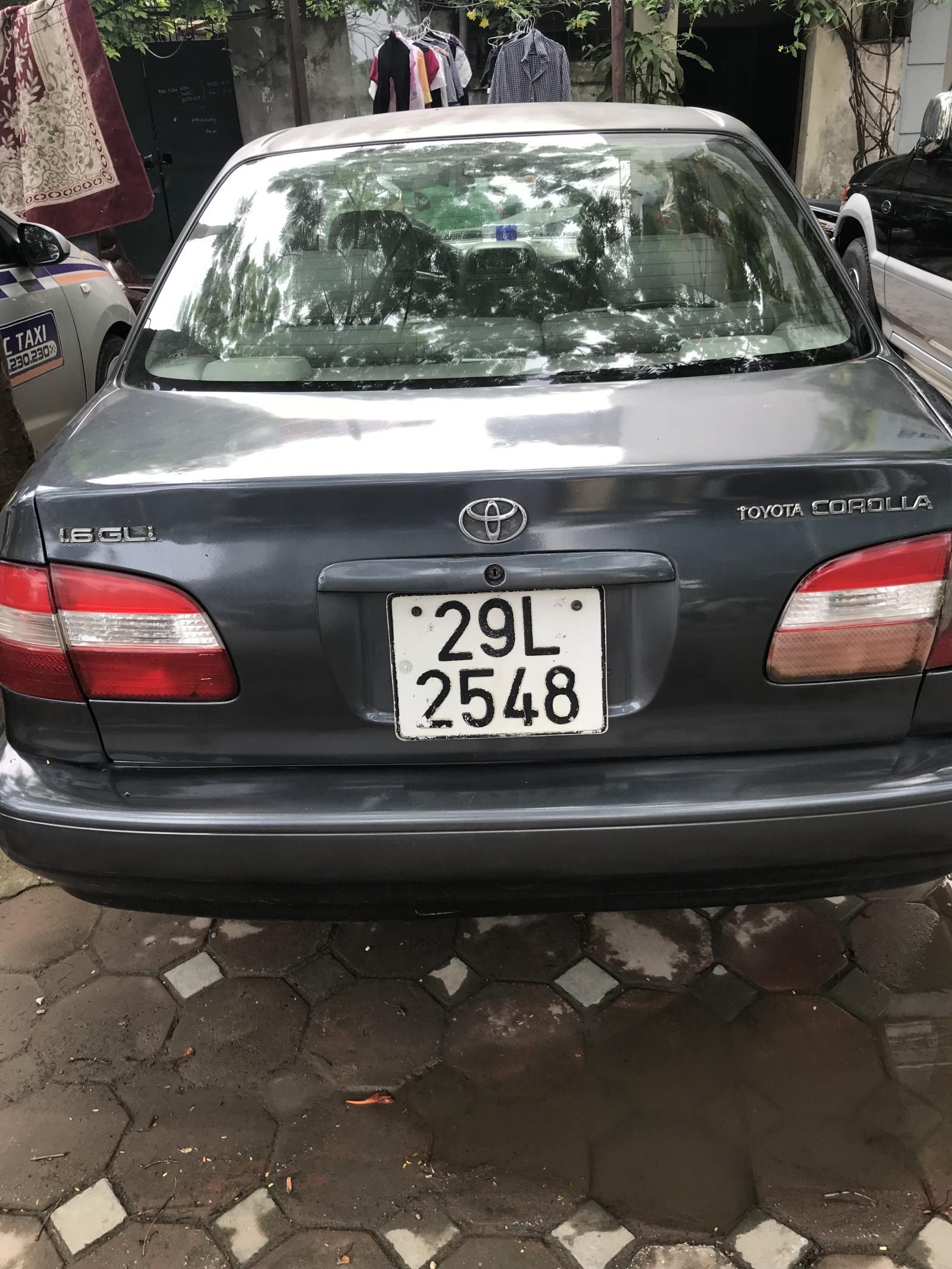 Cần bán xe Toyota Corolla G 1997, màu xám, nhập khẩu nguyên chiếc Nhật Bản
