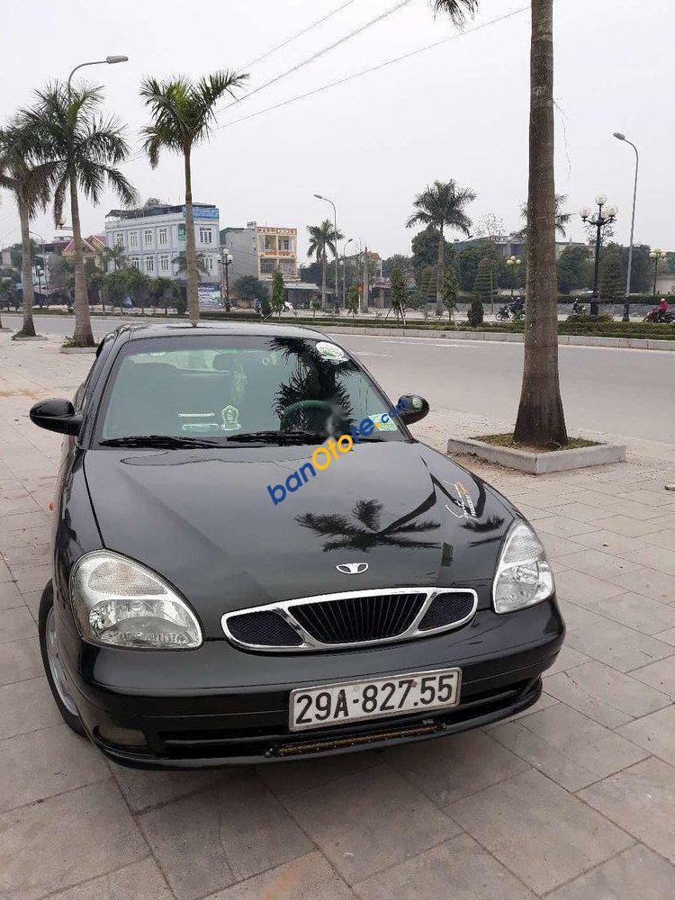 Cần bán Daewoo Nubira sản xuất năm 2002, màu đen, nhập khẩu nguyên chiếc