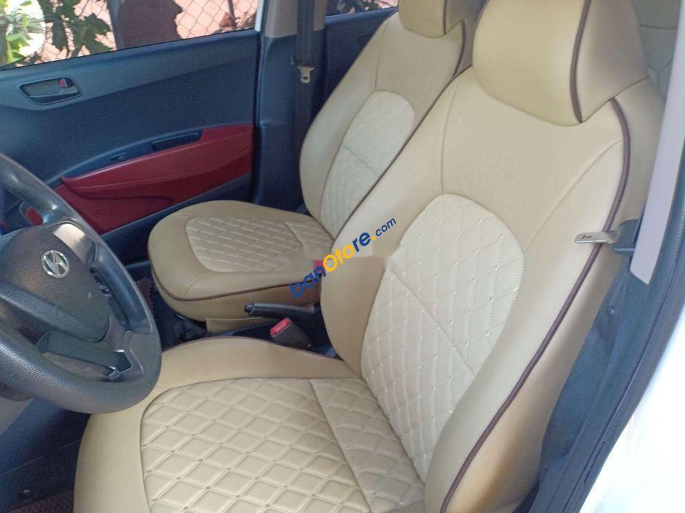 Xe Hyundai Grand i10 sản xuất 2015, màu trắng, nhập khẩu nguyên chiếc xe gia đình