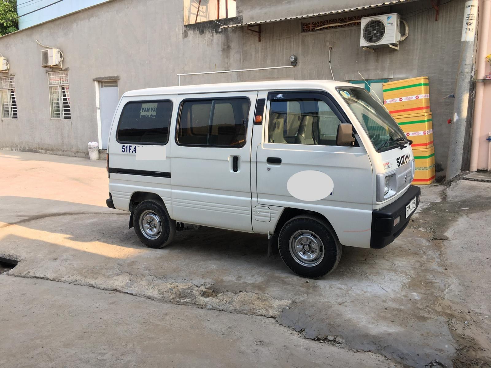 Xe Suzuki Super Carry Van năm sản xuất 2004, màu trắng xe gia đình